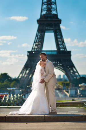 Beautiful just married couple in Paris near the Eiffel tower photo