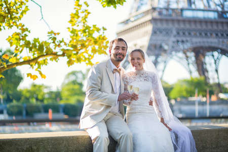 newly married couple: Beautiful just married couple drinking champagne near the Eiffel tower