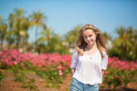 Happy young girl enjoying her vacation in Cannes photo