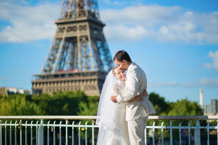 Beautiful just married couple in Paris, near the Eiffel tower photo