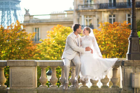Happy just married couple in Paris on a fall day photo