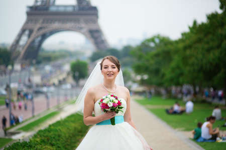 Happy young beautiful bride in Paris, near the Eiffel\ tower