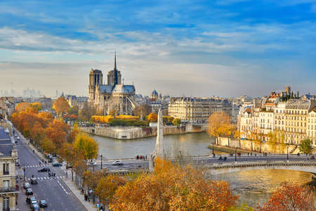 cite: Scenic view of Notre-Dame de Paris with Saint-Louis and Cite islands on a bright fall day