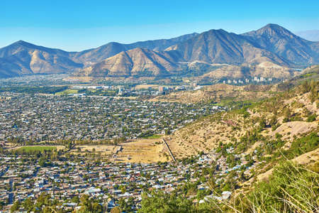 views of the mountains: Scenic view of outskirts of Santiago with Andes mountains, Chile, South America Stock Photo