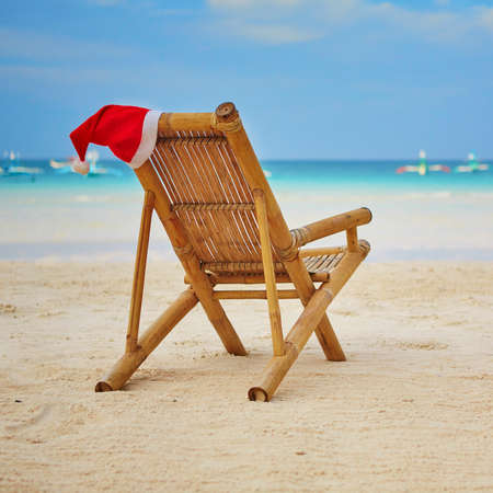 Santa hat on chaise longue on white sand beach on Boracay, Philippines Stock Photo