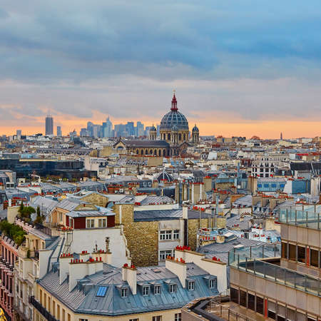 Beautiful Parisian skyline with Saint-Augustin Church with dramatic colorful sunset
