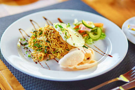 goreng: Mie goreng - spicy fried curry instant noodles, traditional Indonesian meal