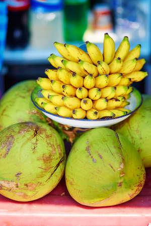 balinese: Fresh bananas and coconuts on a Balinese market