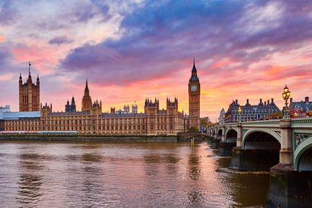 uk: Cityscape of Big Ben and Westminster Bridge with river Thames at sunset, London, UK