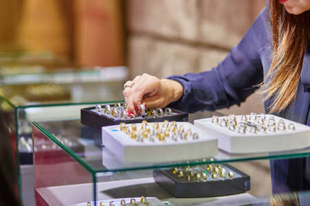 jeweller: Jeweler helping client to choose a wedding ring