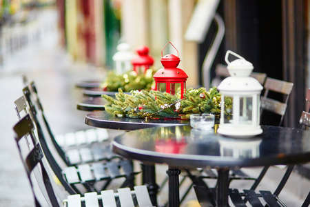Tables of a Parisian outdoor cafe decorated for Christmas Stock Photo