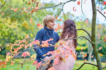 Beautiful dating couple in park on a fall day photo