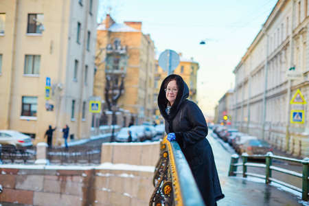 beautiful middle aged woman: Beautiful middle aged woman on Moika embankment in St. Petersburg, Russia