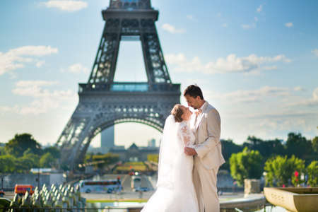 Beautiful just married couple in Paris near the Eiffel tower