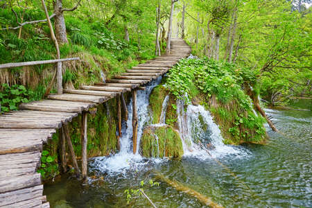 lake: Cascades near the tourist path in Plitvice lakes national park Stock Photo
