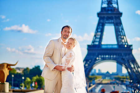 newly wedded couple: Beautiful just married couple in Paris near the Eiffel tower