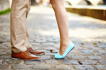 ballerina shoes: Closeup of male and female legs during a date