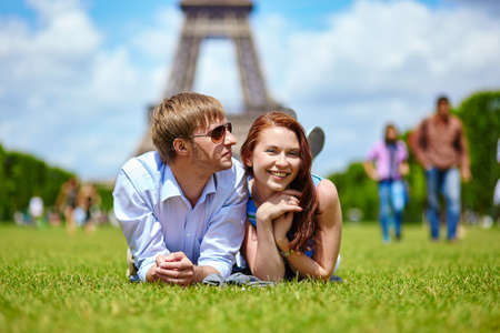 Romantic dating couple in Paris near the Eiffel tower photo