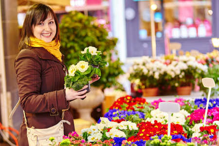 selecting: Beautiful girl selecting flowers at market Stock Photo
