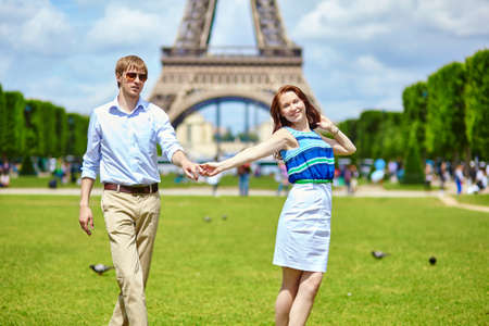 Romantic dating couple dancing in Paris near the Eiffel tower photo
