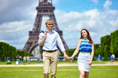 Romantic dating couple walking in Paris near the Eiffel tower photo