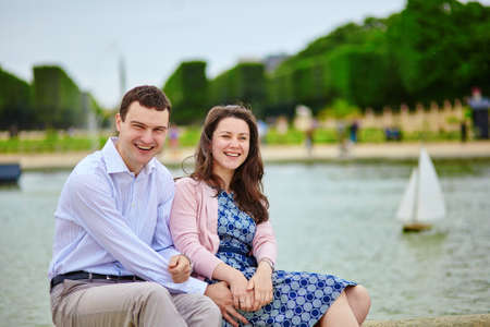 Dating romantic couple in the Luxembourg garden of Paris photo