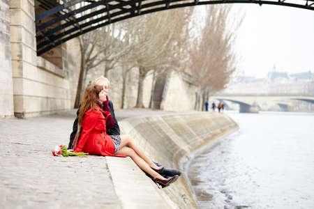 Romantic couple in love having a date near Pont des Arts in Paris Stock Photo - 36228352