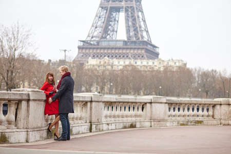Romantic couple in love in Paris, near the Eiffel tower Stock Photo - 36228360