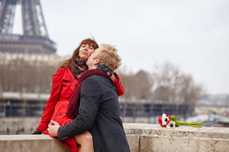 Romantic couple in love in Paris, near the Eiffel tower Stock Photo - 36228363