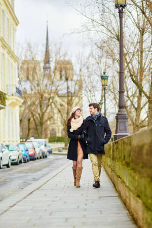 Romantic couple walking together in Paris photo