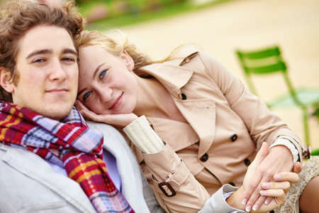 romantic couple: Young romantic couple having a date in the Tuileries garden of Paris Stock Photo