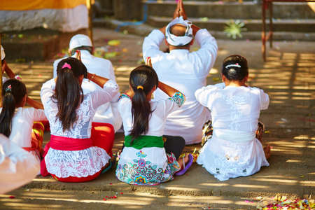 Balinese women praying in a temple during ceremony