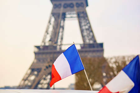 tricolour: French national flag (tricolour) in Paris with the Eiffel tower in the background