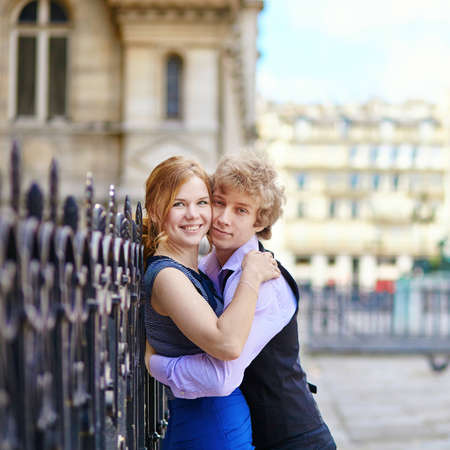 Young romantic couple outdoors in Paris, having fun photo