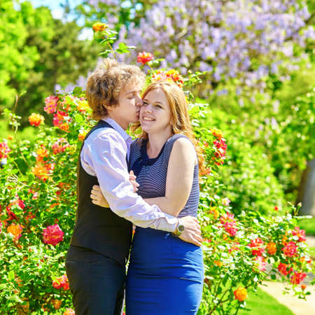 Dating couple in a beautiful park at spring photo
