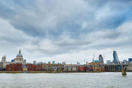 st pauls cathedral: London skyline with St. Pauls cathedral, river Thames and the only pedestrian bridge in London – Millennium bridge