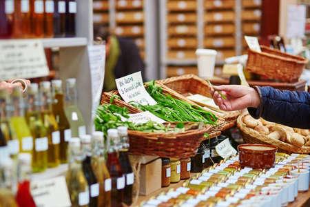Man buying fresh bio leek on London farmer agricultural market
