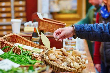 Man buying fresh mushrooms on London farmer agricultural market photo