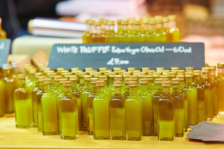 extra virgin: Many bottles with fresh organic extra virgin olive oil with truffles on London farmer agricultural market Stock Photo