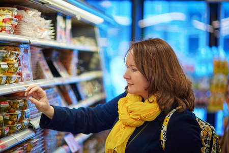 produce departments: Beautiful young woman shopping in a grocery storesupermarket Stock Photo
