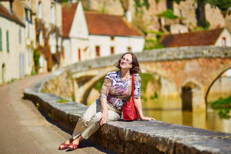 beautiful middle aged woman: Beautiful middle aged woman in Semur-en-Auxois, Burgundy, France