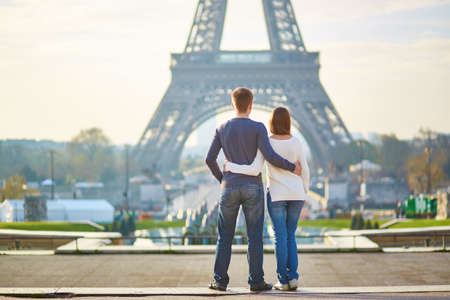 Eiffel Tower: Beautiful romantic couple in Paris near the Eiffel tower