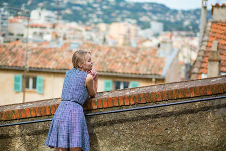 Young beautiful woman on Le Suquet hill in Cannes, France photo