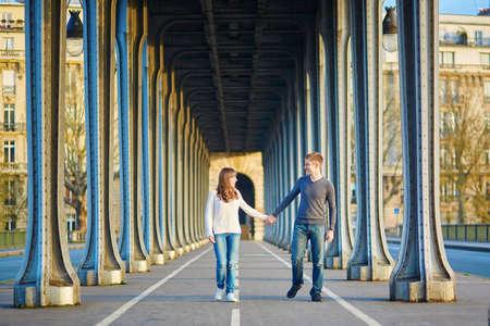 bir: Young romantic couple in Paris on the Bir Hakeim bridge Stock Photo