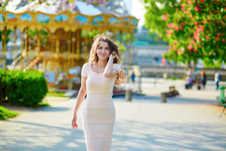 jubilating: Beautiful young woman in Paris, near the Eiffel tower on a nice and sunny spring day Stock Photo