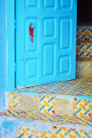 doorstep: Blue door and doorstep in Medina of Chefchaouen, Morocco, small town in northwest Morocco known for its blue buildings Stock Photo
