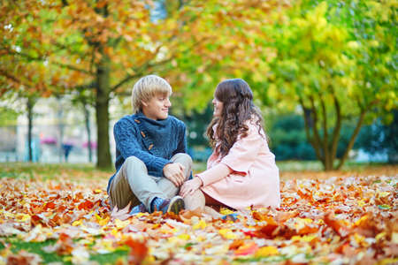 Young romantic couple in Paris, enjoying beautiful autumn day photo