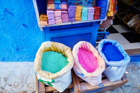 colorant: Colorants for sale on a street in Medina of Chefchaouen, Morocco, small town in northwest Morocco known for its blue buildings