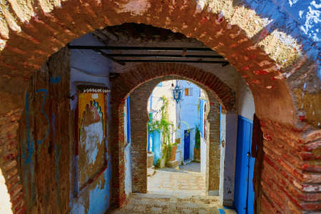 north window arch: Street in Chefchaouen, Morocco, small town in northwest Morocco known for its blue buildings