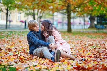 Young romantic loving couple in Paris, dating and enjoying nice autumn day together photo